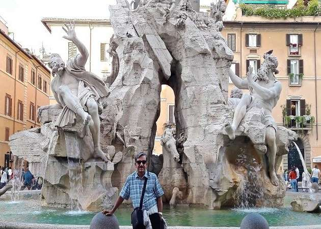 Mr. Abhishek outside a fountain in Rome