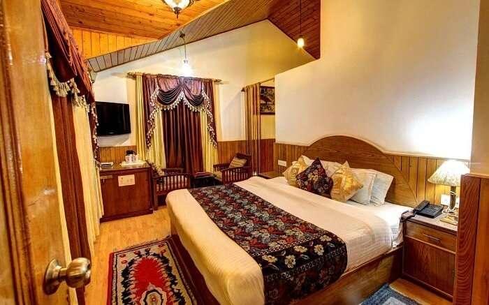 apple bud cottages manali bedroom