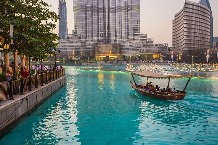 Tourists take a boat ride in the Burj Lake