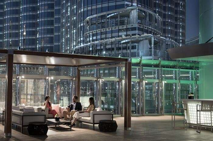 Guests relax at the Burj Club Rooftop in Burj Khalifa