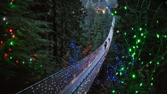 Glittering night view of walkway to Capilano Suspension Bridge in Vancouver