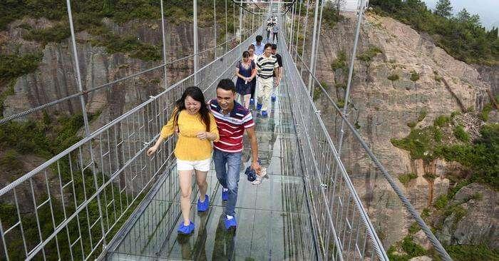 People enjoying the thrill of Haohan Qiao Bridge in China
