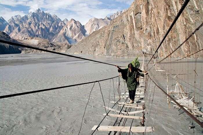 Women crossing over the dilapidated Hussaini Hanging Bridge in Northern Pakistan