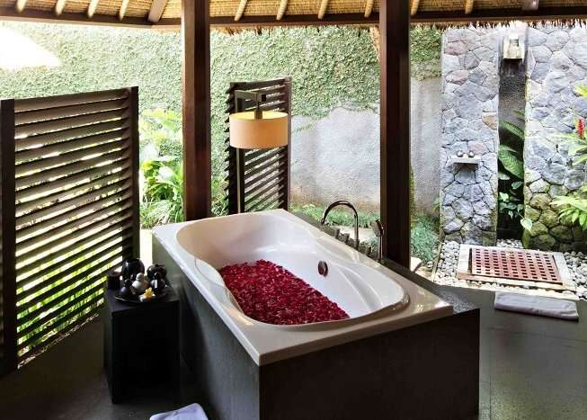 bathroom in Kayumanis Ubud Private Villas & Spa with bathtub