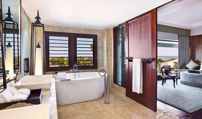 lavish bathroom with bathtub in St. Regis Bali Resort