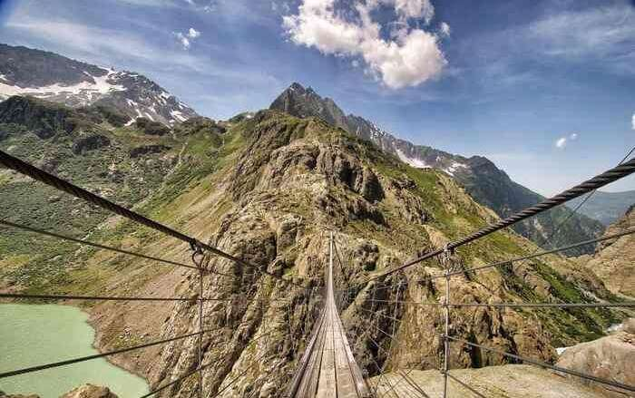 The swingy Trift Bridge in Swiss Alps