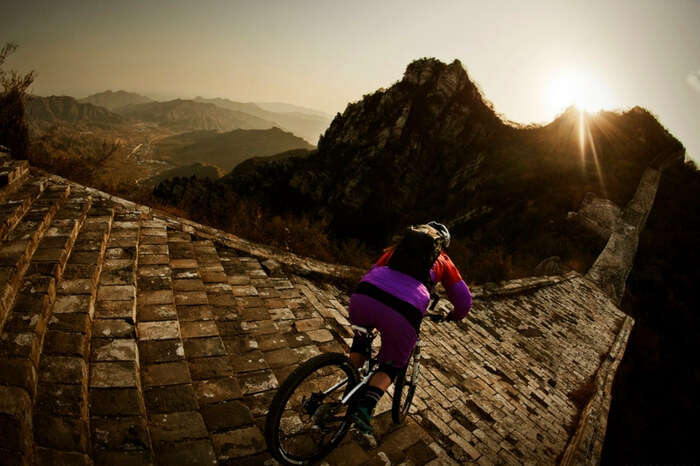 A rider attempting biking on The Great Wall of China