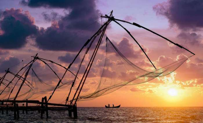 The morning rituals of throwing fishing nets in the sea at Veeranpuzha Beach