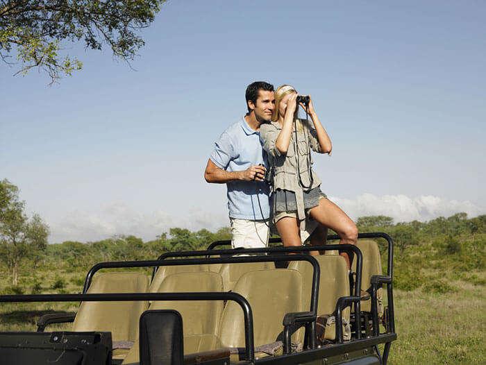 A couple enjoying a Jeep Safari ride at the Kalakkadu Wildlife Sanctuary