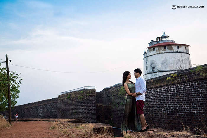 A couple romancing in privacy at Aguada Fort in Goa