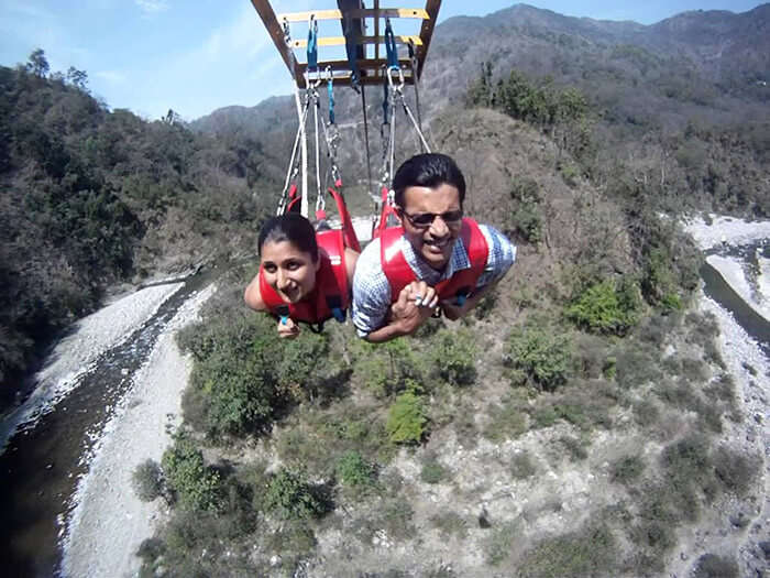 A couple celebrating Valentine's Day by engaging in adventure activities like flying fox at Rishikesh