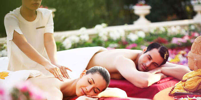 A couple indulging in Couple's Spa Treatment at Ananda Spa Resort
