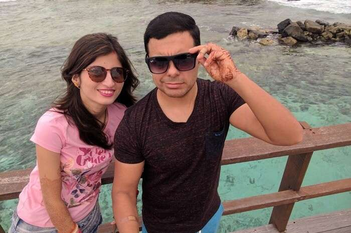 Couple clicking selfie near water villa