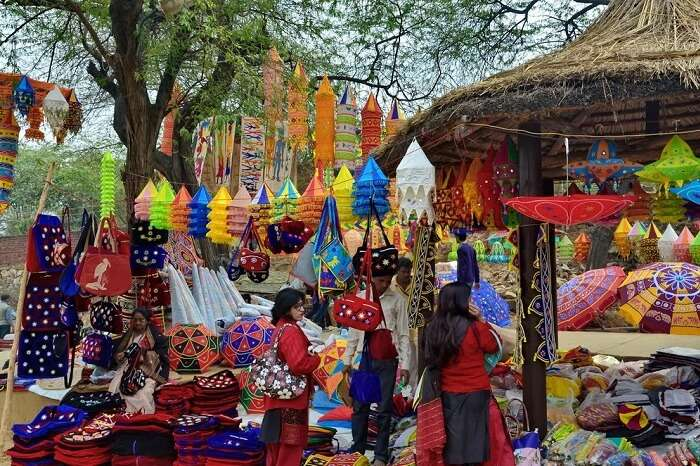 Tourists buying colorful products at the Surajkund Mela in Faridabad