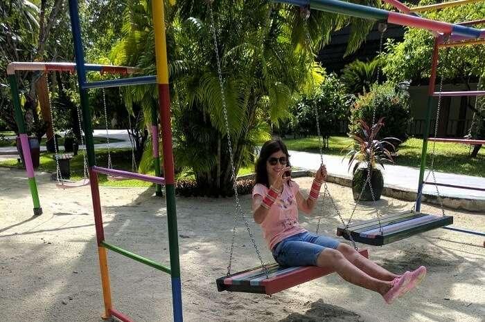 woman enjoying swinging