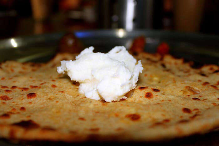 savour the taste of delicious paranthas loaded with white butter at murthal