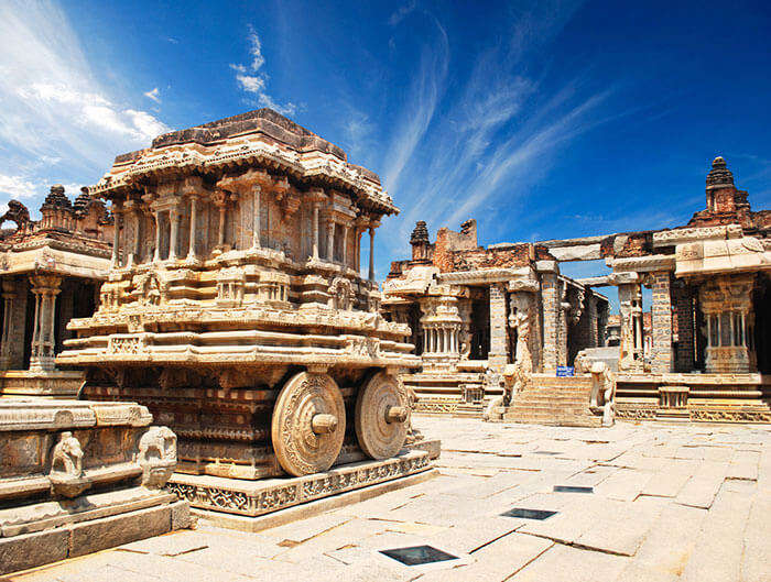 dwell in the rich architecture of the temples at hampi at no cost at all