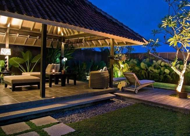 open lounge area with recliners near private pool in villa komea