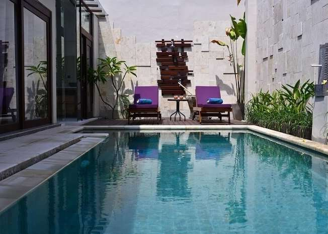reclining chairs near private pool of zoe villa