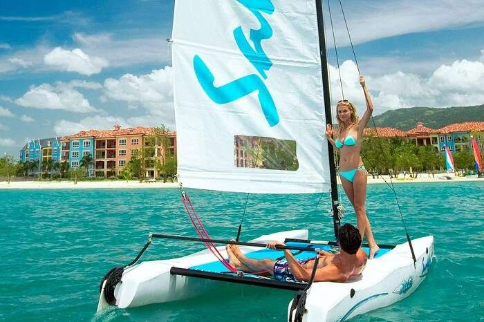 kw-030617-A couple riding a Hobie Cat near a resort on their Caribbean honeymoon