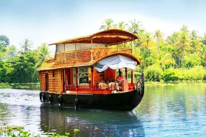 Houseboat ride at beautiful backwaters of Kumarakom Kerala
