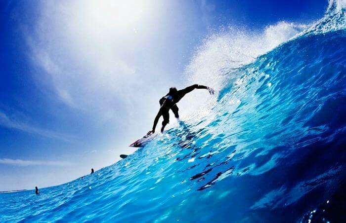 A professional sea surfing at Arugam Bay on a Sri Lankan beach