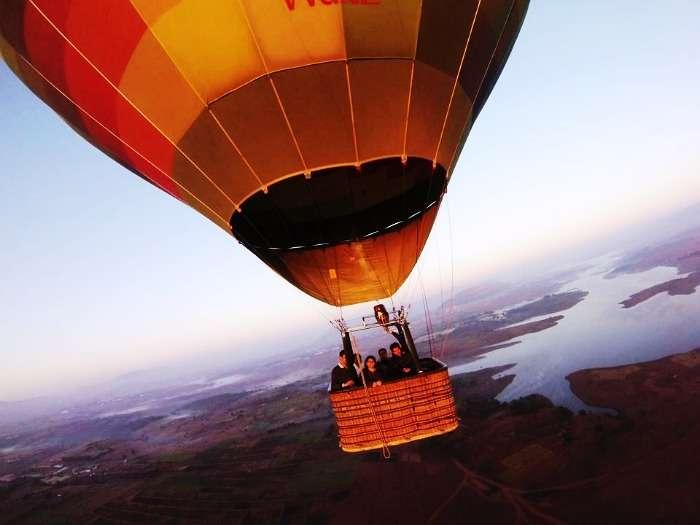 Family enjoying a hot air balloon ride in Lavasa, Maharashtra