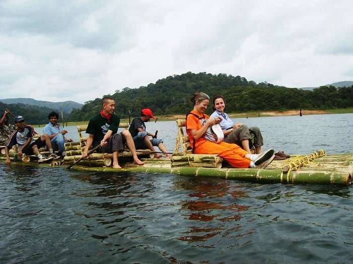 People enjoying a bamboo- raft ride in Wayanad, Kerala