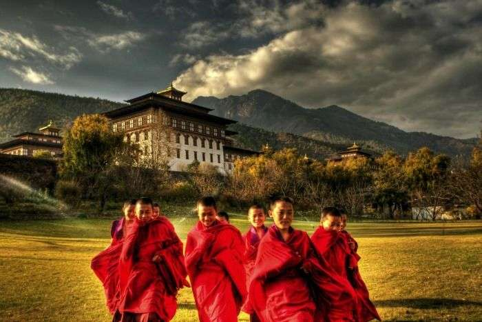 Monks in front of Gangtey Monastery in Bhutan
