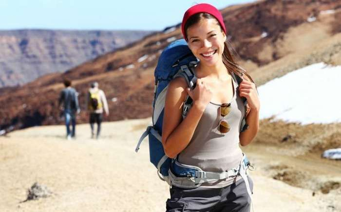 A solo girl backpacker on her way to a adventure
