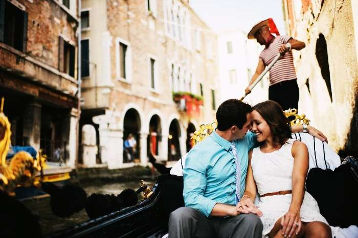 A couple taking a romantic gondola ride in Venice