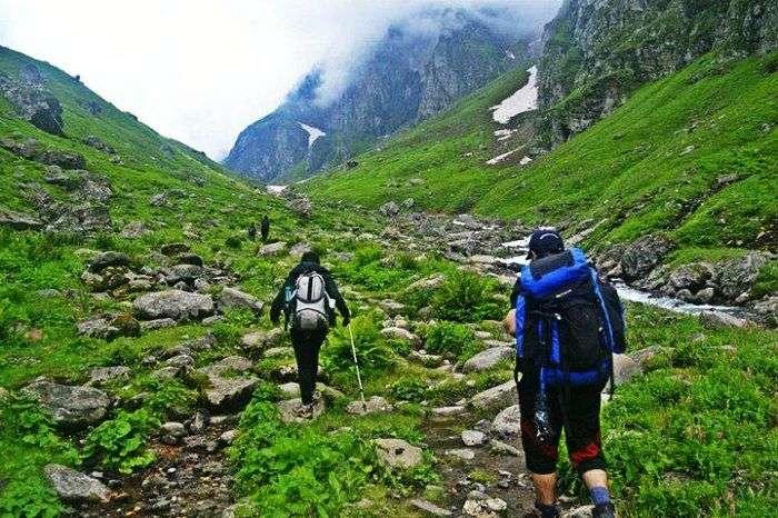 Trekkers hiking through the trails of Hampta Pass