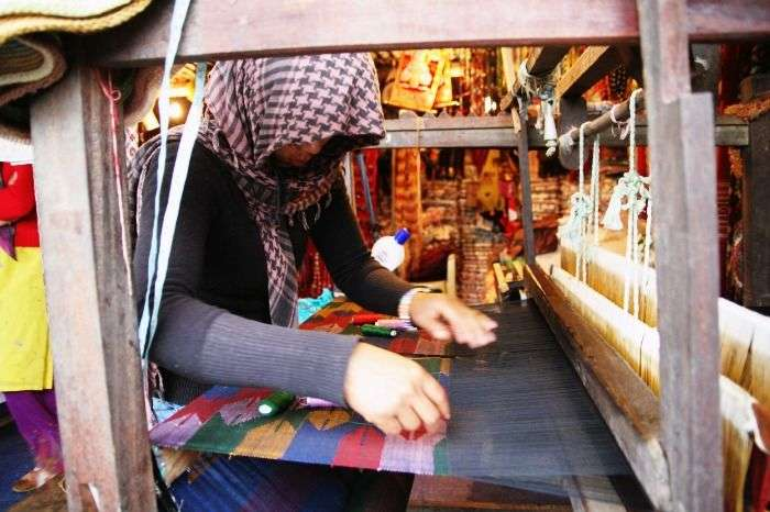 Hand made Pashmina on the loom by a textile worker