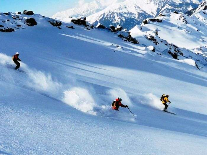 Enjoy skiing in the picturesque snow-capped peaks of Auli