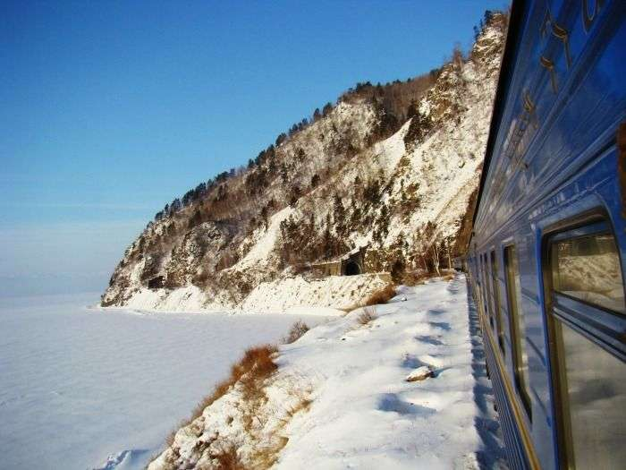 A train rushes past the frozen Lake Baikal, the world's oldest and deepest freshwater lake