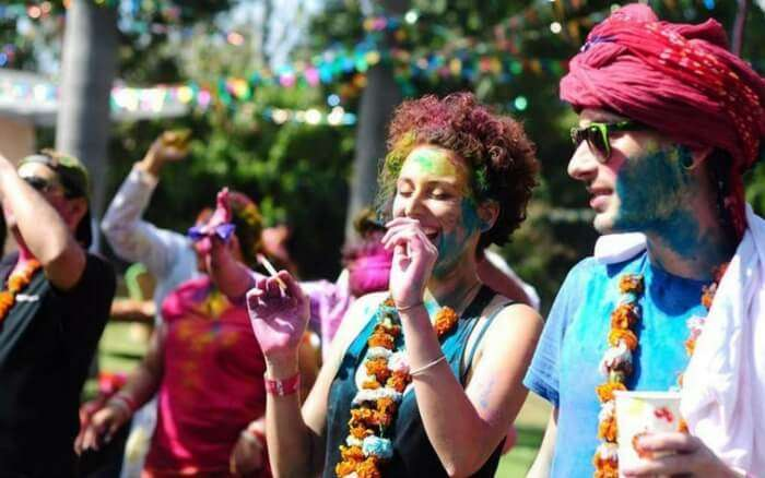 People playing with colors during Holi Cow festival in Delhi