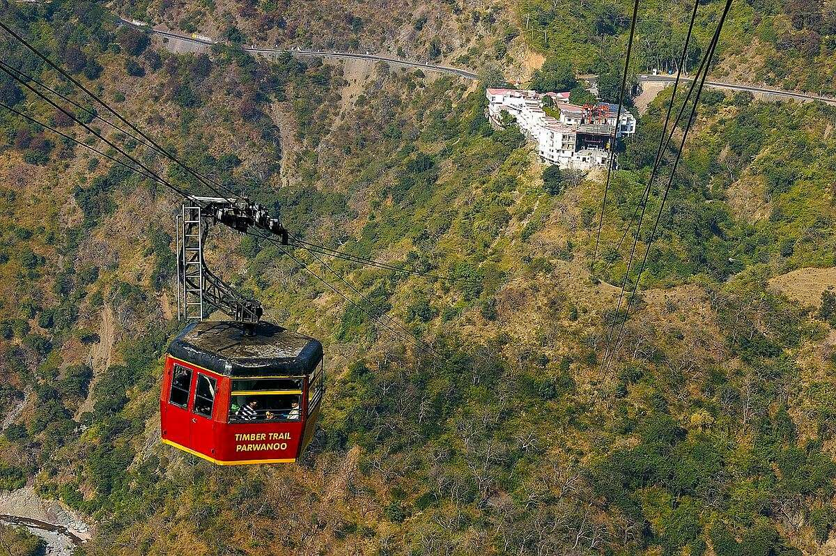 a red colour cable car in mountains