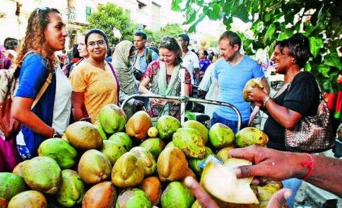 Tourists enjoying Coconut water