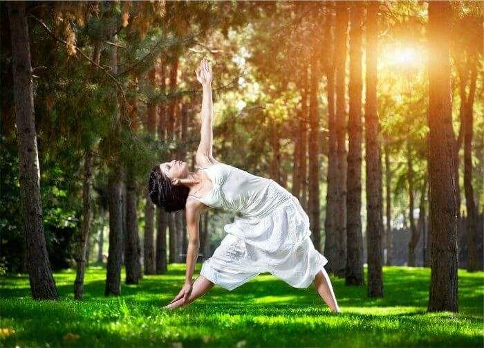 A girl practising yoga at Ayurveda Yoga Meditation Resort in Coonoor one of the best yoga retreats in India
