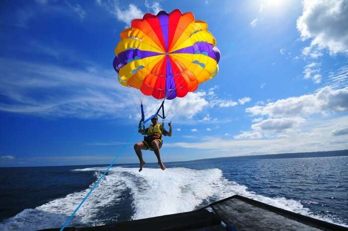 A man parasailing in the waters of Andaman