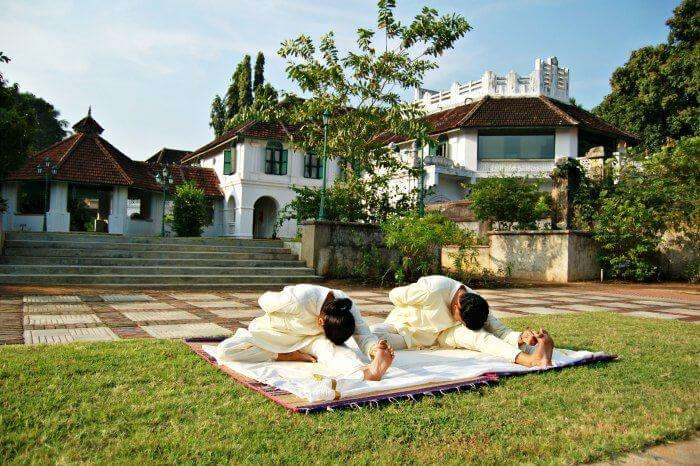 People practising yoga at one of the best yoga and meditation retreats in India - Kalari Koavilakom