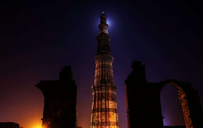 Start a night walk in Delhi from Qutub Minar on a full moon night.