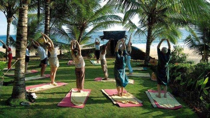 People practicing yoga at Sivananda Yoga Vedanta Dhanwantari Ashram in Kerala