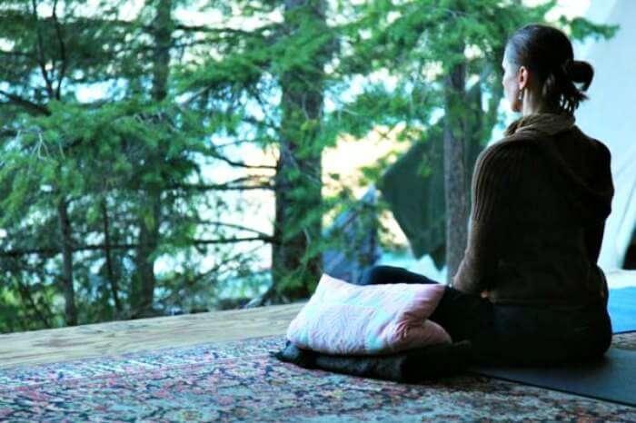 A lady meditating at the Tushita meditation centre in Dharamshala
