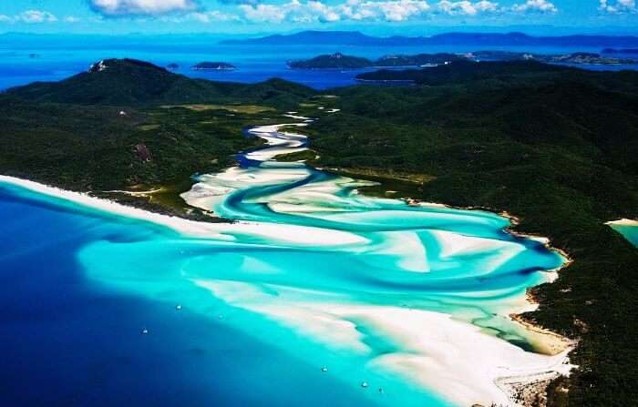 White sandy beaches and azure waters of Whitsunday make it an amazing honeymoon spot in the world