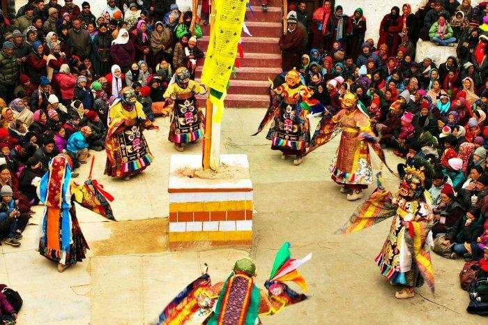 Mask wearing dancers performing at the Ladakh Festival