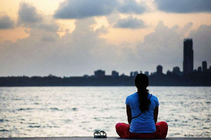 A girl sitting on marine drive in Mumbai