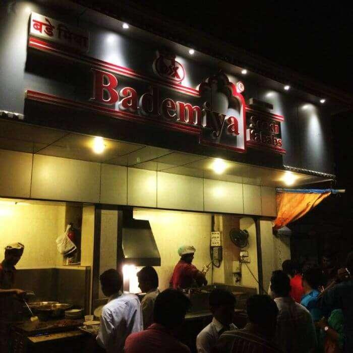 People trying some delicious food at Bademiya in Mumbai at night