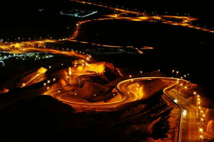 The well-lit road of Drive Jebel Hafeet, UAE