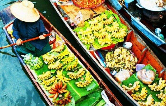 One of the best places to see in Thailand are the colorful floating markets